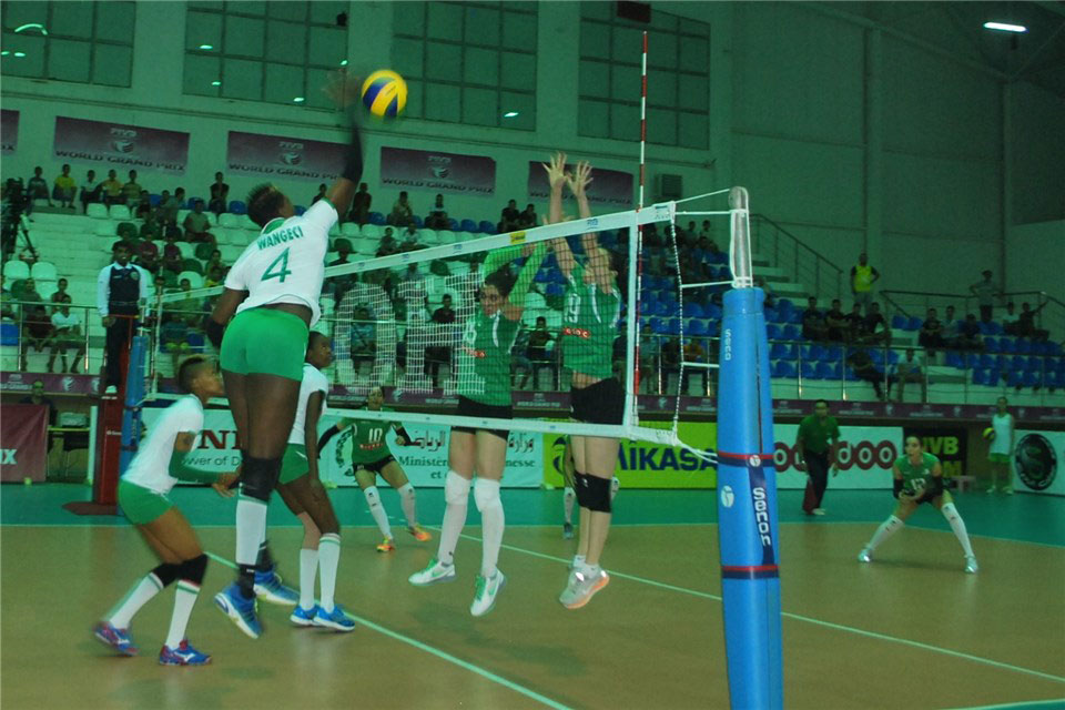 Esther Wangechi (left) rises for a shot against Algeria on Sunday. PHOTO/FIVB