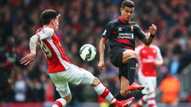 Hector Bellerin of Arsenal and Philippe Coutinho of Liverpool compete for the ball during the Barclays Premier League match between Arsenal and Liverpool at Emirates Stadium on April 4, 2015 in London, England. PHOTO/Yahoo!/Getty