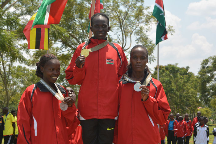 Perine Nengampi (centre) who retained her women 8km Military Games title poses with silver medallist Sela Jepleting (right) and bronze winner, Doris Changeiywo in Jinja, Uganda on August 19, 2015. PHOTO/KDF