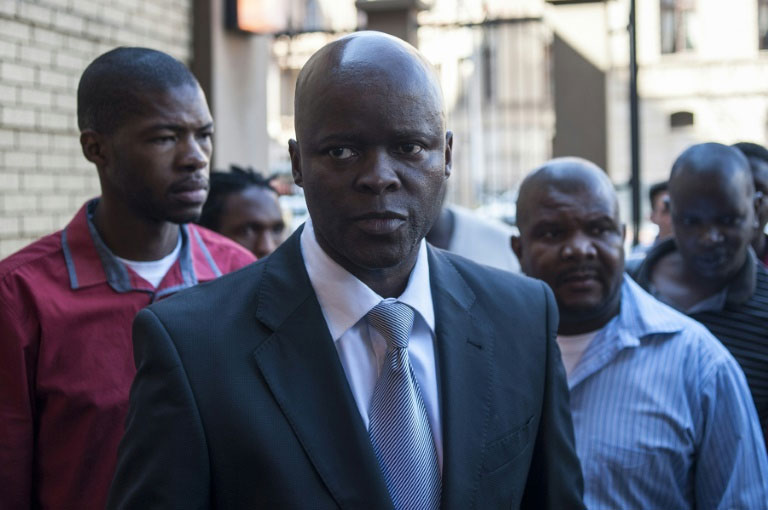 Edward Mokhoanatse, president of political party the Agency for a New Agenda (ANA), arrives at the North Gauteng High Court in Pretoria on September 2, 2015. PHOTO/AFP