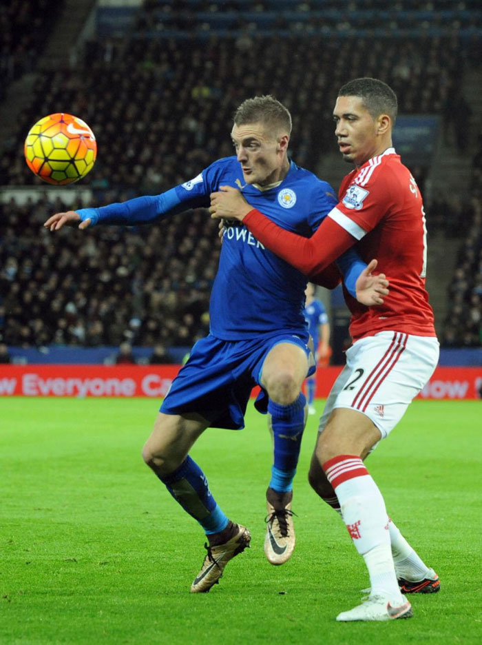 Leicester City's Jamie Vardy (left) shields the ball from Chris Smalling of Manchester United in their BPL clash on Saturday, November 28, 2015. PHOTO/AP