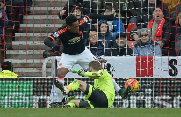 Manchester United goalkeeper David de Gea (in yellow) accidentally knocks in a shot from Sunderland's Lamine Kone (not pictured) (AFP Photo/Oli Scarff)