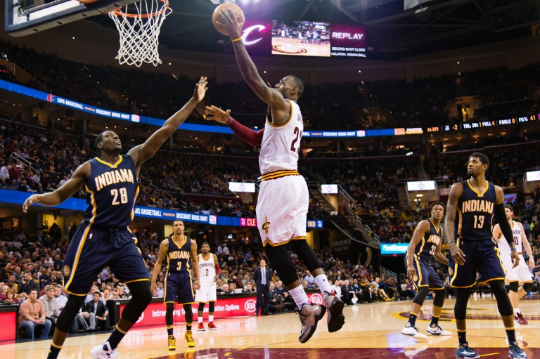 LeBron James of the Cleveland Cavaliers shoots over Ian Mahinmi of the Indiana Pacers during the second half at Quicken Loans Arena. PHOTO/AFP