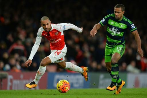 Arsenal's midfielder Theo Walcott (L) takes on Swansea City's midfielder Wayne Routledge (R) during the English Premier League football match at the Emirates Stadium in London on March 2, 2016