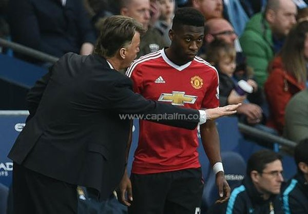 Manchester United's Dutch manager Louis van Gaal (L) gives instructions to Manchester United's Dutch defender Timothy Fosu-Mensah during an English Premier League football match against Manchester City on March 20, 2016