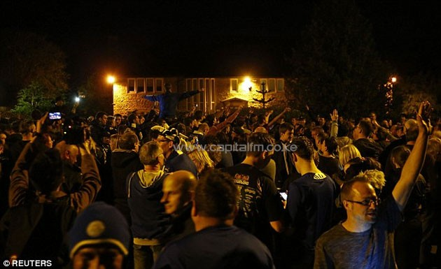 Fans celebrate outside Vardy's house in Melton Mowbray after Leicester were confirmed as champions.