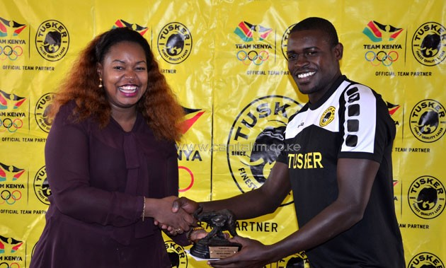 Michael Khamati receiving the Tusker FC's Player of the Month for May.