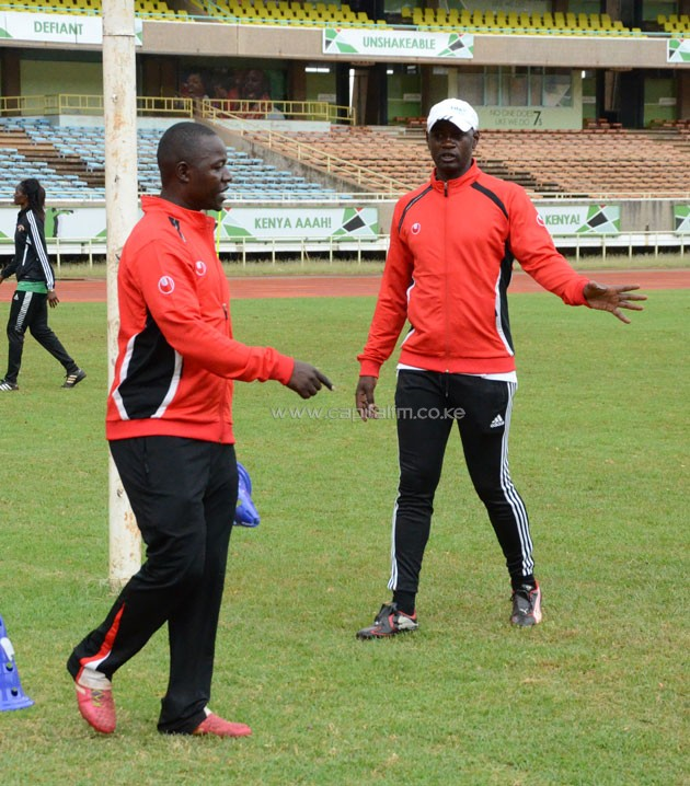 Harambee Starlets head coach David Ouma (left) shares a word with goalkeeper trainer Lawrence Webo (right) in a past training session. PHOTO/TIMOTHY OLOBULU