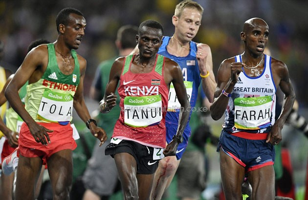 Kenya's Paul Tanui gallops behind Farah in the final straight of the race. PHOTO/DAILYMAIL