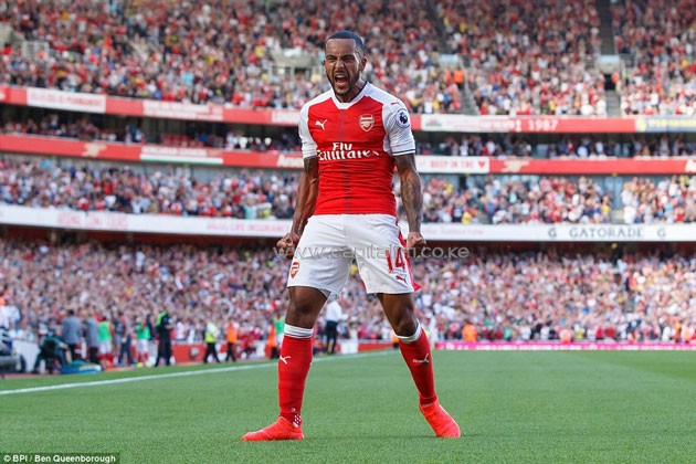 Walcott roars in front of the home fans having scored for the Gunners in the Premier League clash with Liverpool.PHOTO/courtesy.