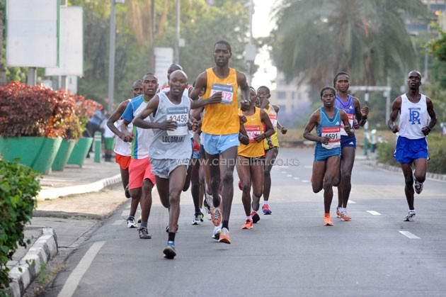 John Njogu (on grey vest) with the 42km pack at Parliament Road.PHOTO/Raymond Makhaya