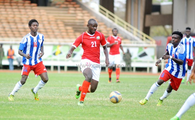 Harambee Stars midfielder Osborne Monday controls the ball in midfield under pressure from Liberian opponents. PHOTO/Raymond Makhaya