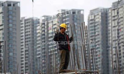 A man carrying out construction work in China/AFP