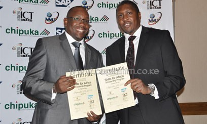 Paul Kukubo (R) at a previous function in his capacity as CEO of the Kenya ICT Board