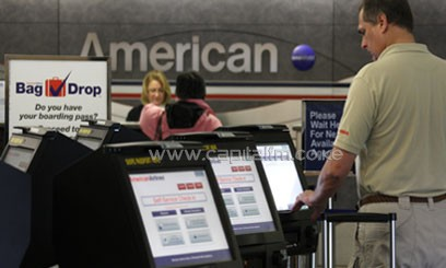 A passenger uses the self-service check-in system at the La Guardia airport in New York/XINHUA-File