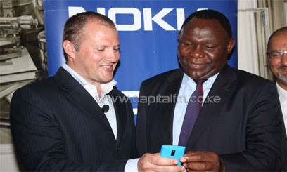 Nokia GM for East Africa Bruce Howe[left] and Information PS Bitange Ndemo [right] at the launch of Nokia Life. Photo/ FILE