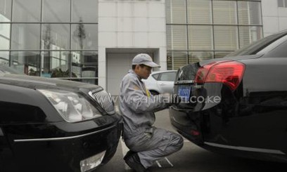 A worker at a car factory/FILE