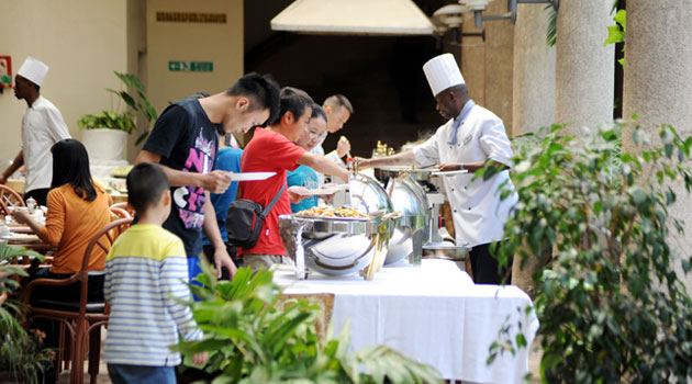 Tourists being served at a Nakuru hotel/XINHUA FILE