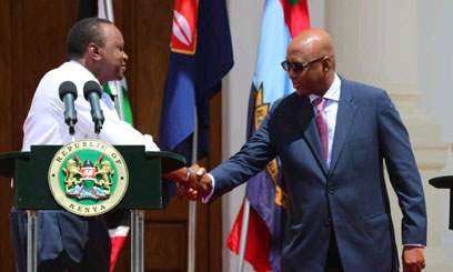 Adan Mohamed with President Uhuru Kenyatta when he was appointed to the Cabinet. Photo/FILE