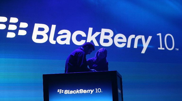 Workers prepare the podium before the start of the BlackBerry 10 launch event by Research in Motion at Pier 36 in Manhattan on January 30, 2013 in New York/ AFP