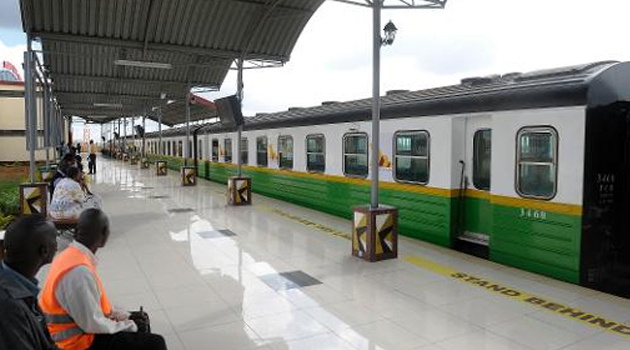 Passengers wait to board a newly inaugurated train at a station on the outskirts of Nairobi, on November 16,2012/AFP