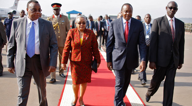 President Kenyatta and First Lady Margaret are received by Kenyan High Commissioner  to Rwanda Amb.John Mwangemi (L) and Rwadan Senior Government officials Minister  led by Minister for Justice John Busingye  (R)on arrival at Kigali International Airport, Rwanda/PSCU