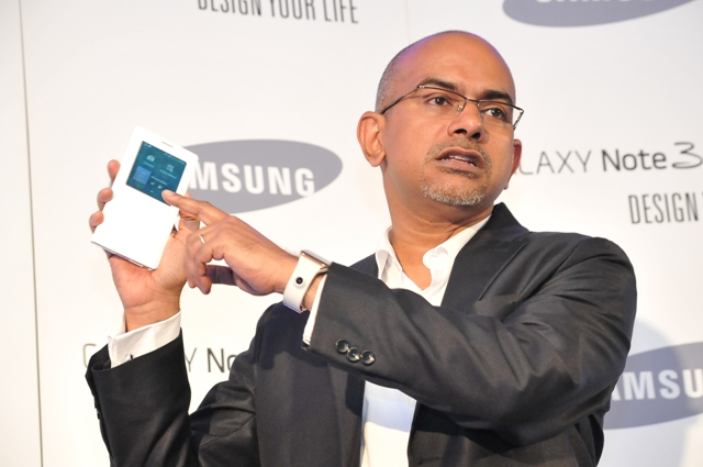 Manoj Changarampatt, Business Leader Hand Held Products Samsung Electronics EA, displays the Note 3 and gear.