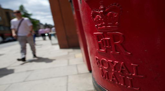 A Royal Mail post box stands on a street in London on July 10, 2013/AFP