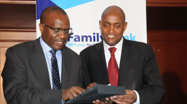 Family Bank CEO and Finace Director compare notes before presenting the bank's performance/CFM