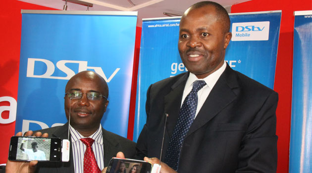 Airtel Kenya head of Corporate Communications and Brand Dick Omondi and DStv Mobile General Manager Felix Kyengo display the DStv Drifta during the partnership launch this morning/CFM