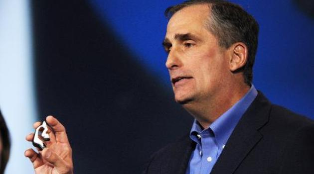 Intel Corp. CEO Brian Krzanich displays the Intel smart headset and earbud designs, providing full stereo audio, heart rate monitor and pulse check, during his keynote address at the 2014 International CES, January 6, 2014 in Las Vegas/AFP