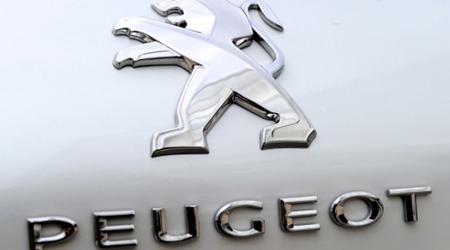 The Peugeot logo /AFP