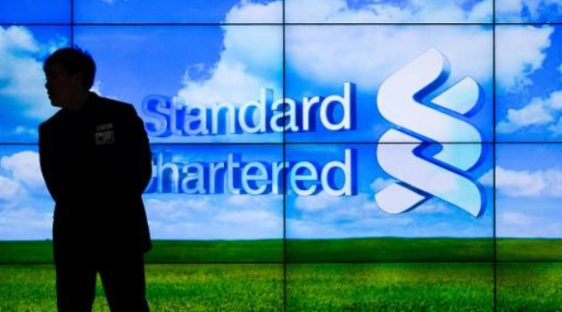 Standard Chartered bank says 2013 net profit down 16% /AFP
