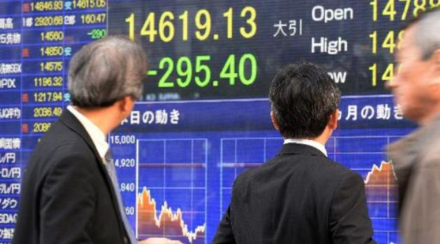 Tokyo's Nikkei-225 index dived 610.66 points to close at 14,008.47/AFP