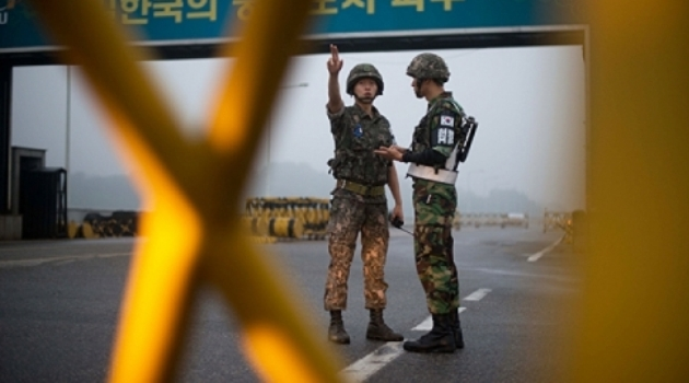 South Korean soldiers stand at a military checkpoint leading to North Korea's Kaesong joint industrial complex, in the border city of Paju/AFP