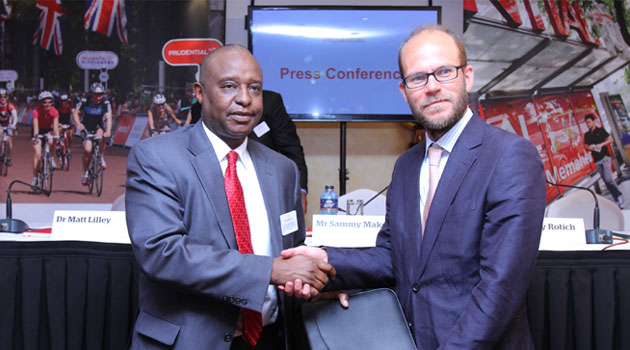Dr Matt Lilley Prudential Africa CEO exchange the acquisition document with Cabinet Secretary of the National Treasury Henry Rotich. Prudential Plc announced its entry in Kenya through acquisition of Shield Assurance/FILE