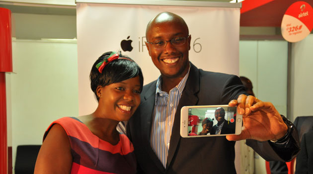 Microensure's Adeline Onyango and Airtel's Charles Wanjohi take a selfie with an iPhone 6 Plus/CFM BUSINESS