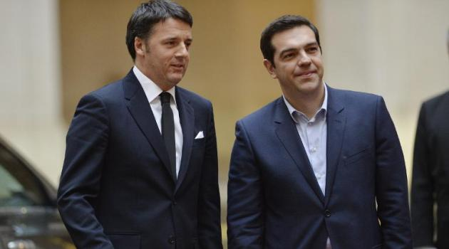 Greek Prime Minister Alexis Tsipras (R) is welcomed by Italian Prime Minister Matteo Renzi before their meeting on February 3, 2015 at the Palazzo Chigi in Rome/AFP