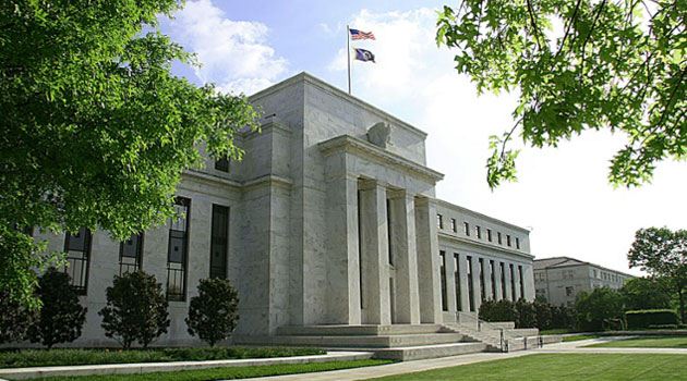 The Federal Reserve raised the benchmark federal funds rate, locked near zero since the Great Recession, by a quarter point to 0.25-0.50 percent/AFP