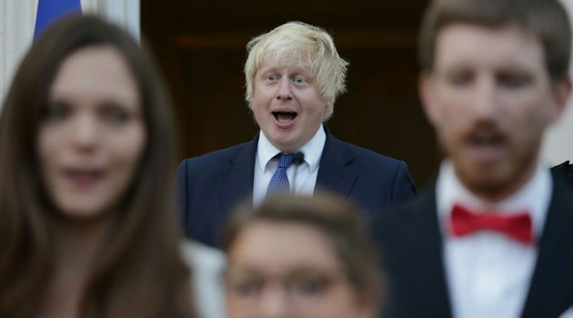 British Foreign Secretary Boris Johnson (C) sings the French national Anthem during a reception at the French Ambassador's residence in west London, on July 14, 2016/AFP