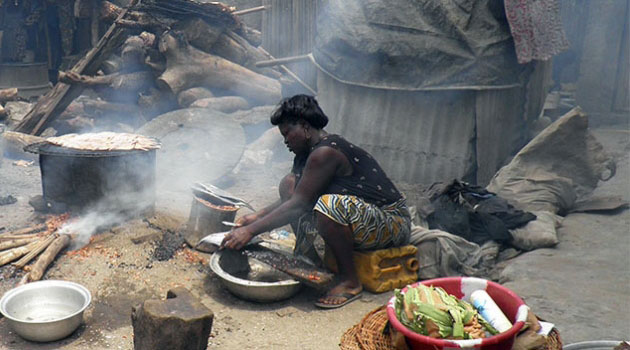 BENIN WOMEN FIREWOOD - Upaid care and domestic work is borne by women and girls in Kenya, Oxfam