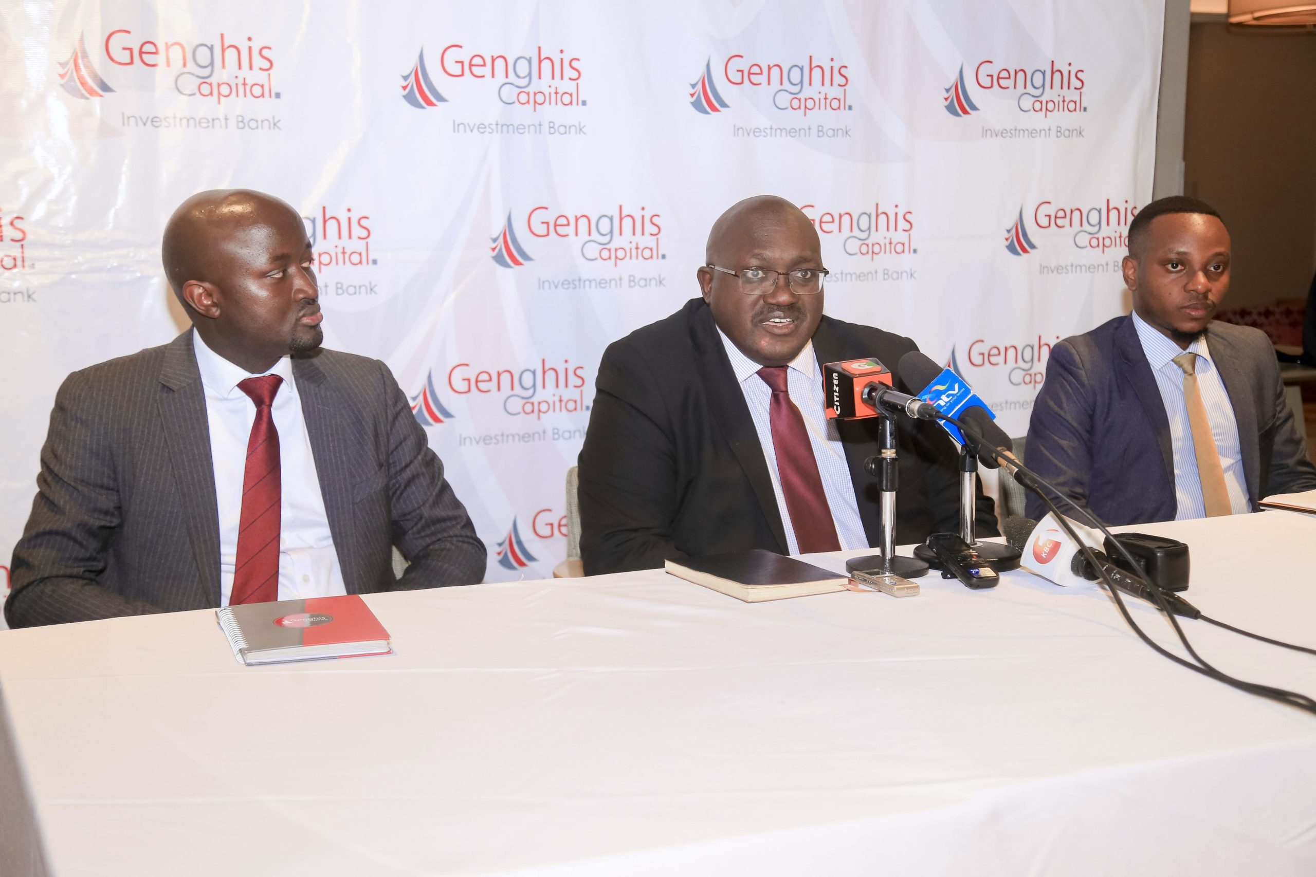Genghis Capital CEO Geoffrey Gangla Centre with the firms Senior Research Analyst Churchill Otieno left and Patrick Mumu Equity Research Analyst at Genghis Capital during the release of the firm scaled - Trading activities at NSE expected to increase in 2020 – Genghis