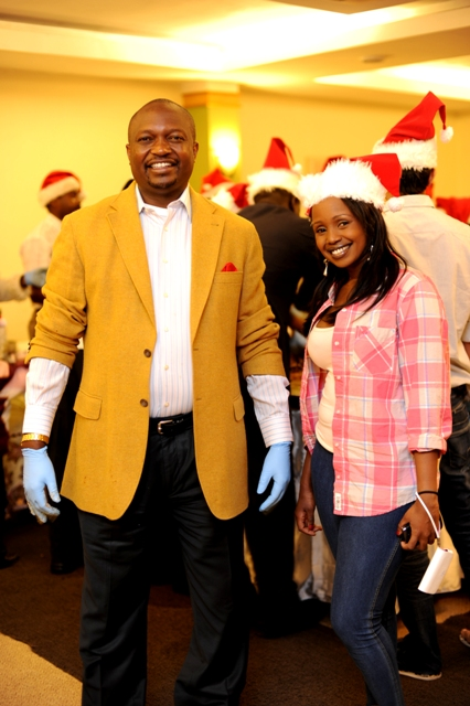 Musician, Amani with Anthony Ngunga General Manager at Sarova Panafric's annual Cake Mixing photographed by Susan Wong Nov 2011