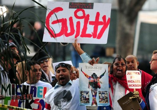 Supporters of Michael Jackson hold placards outside the courthouse where Conrad Murray's trial was being held in Los Angeles on November 7, 2011. Murray was found guilty over the King of Pop's 2009 death, triggering an explosion of joy from his family and fans. © AFP Frederic J. Brown