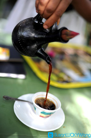 Habesha Restaurant in Nairobi Kenya photographed by Susan Wong 2012 - pouring coffee