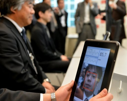 A Fujitsu engineer demonstrates how a smartphone that can take the pulse of a user just by looking at his or her face works