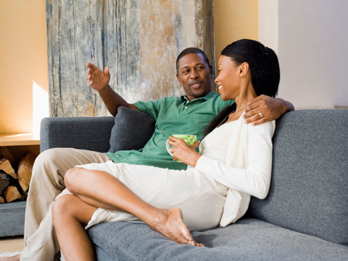 black-couple-talking-couch