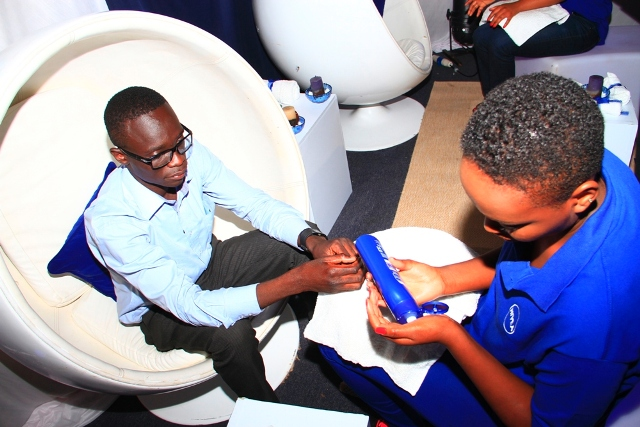 A guest enjoys a skin massage at the NIVEA flagship Rebrand at Crowne Plaza