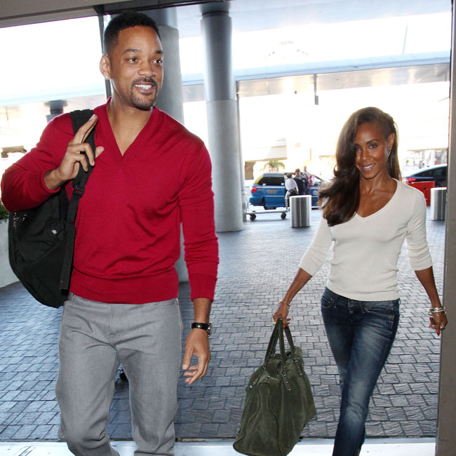 Will Smith and wife Jada Pinkett Smith arriving at the Los Angeles International Airport