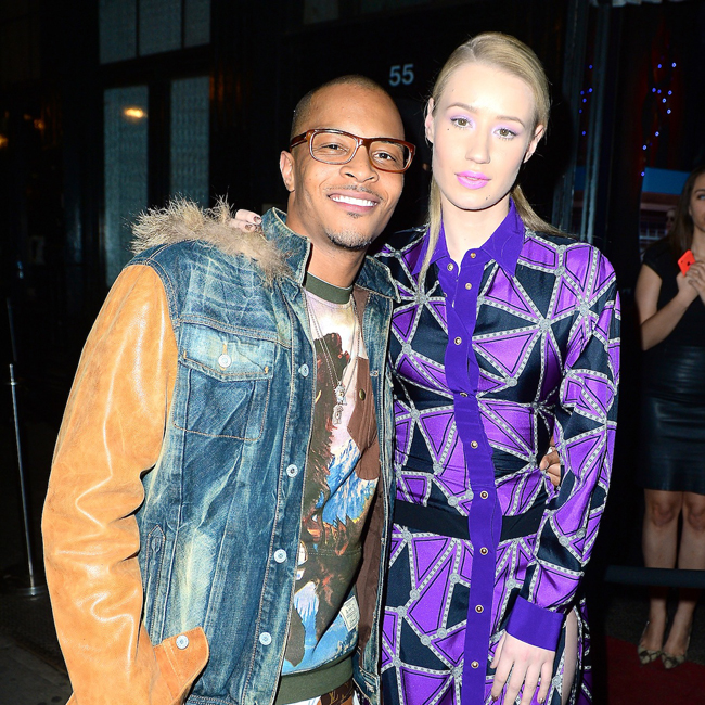 Iggy Azalea performs with T.I. in NYC wearing a  floor length purple gown